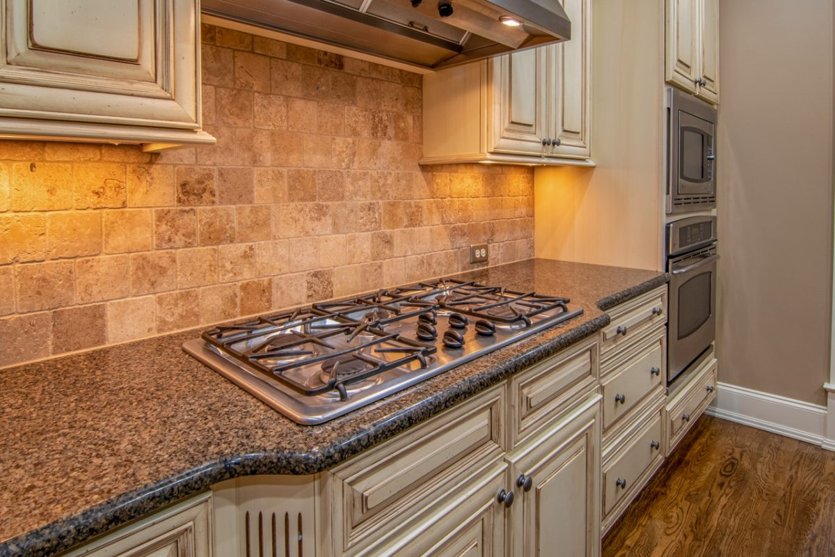 a kitchen with metal surfaces